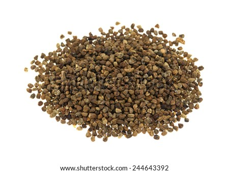 A group of cardamom seeds on a white background. - stock photo