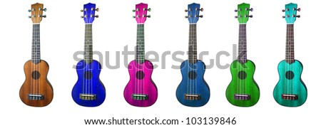 A group of cheap colorful ukuleles - stock photo