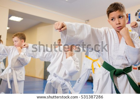 A group of children in the classroom for Taekwondo in the gym. Editorial. Rybinsk, Russia.  12.11.2016