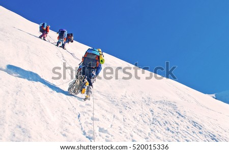 A group of climbers reaching the summit