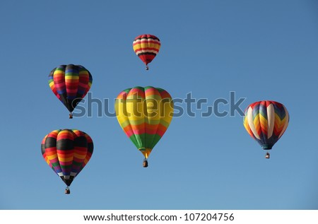 A group of colorful hot air balloons against a blue sky. Taken at the Albuquerque Balloon Fiesta in New Mexico - stock photo