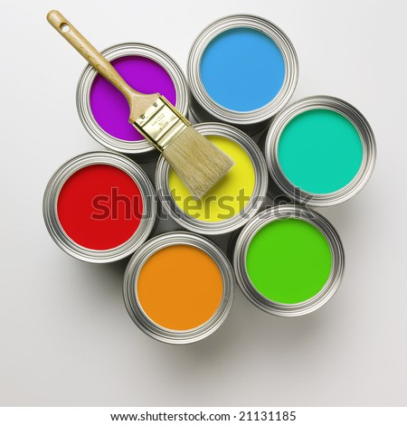 A group of colorful paint cans with paintbrush - stock photo