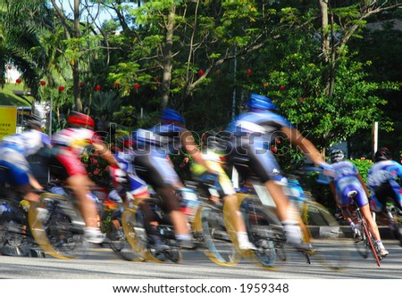 A group of cyclist racer descending from a hill