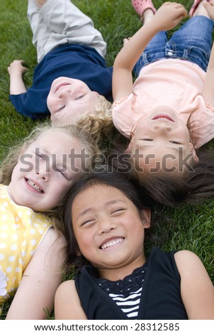 A group of diverse young kids playing - stock photo