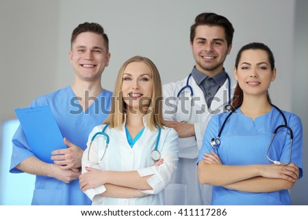 A group of doctors and nurses standing in the hospital, indoors