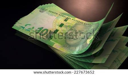 A group of five rand banknotes fanned out and curved on an isolated white background