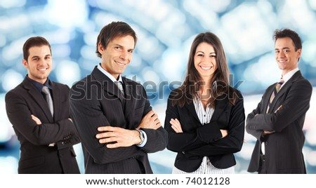 A group of four businesspeople isolated on white. - stock photo
