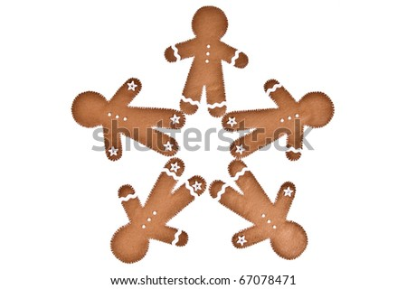 a group of gingerbread men made of felt - stock photo