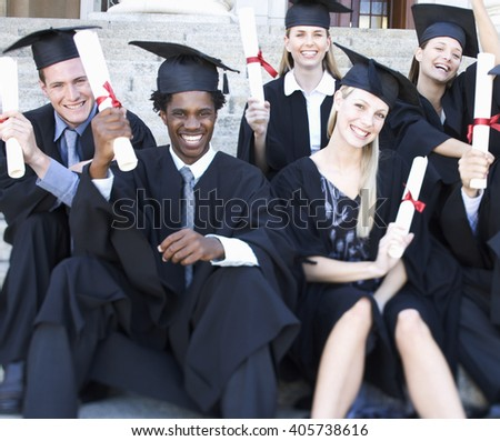 A group of graduates celebrating - stock photo