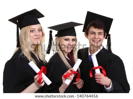 A group of graduates one male and two female holding scrolls, isolated against white