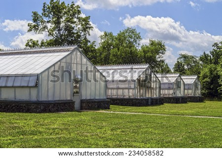 A group of greenhouses on a Summer day in Central New Jersey. - stock photo