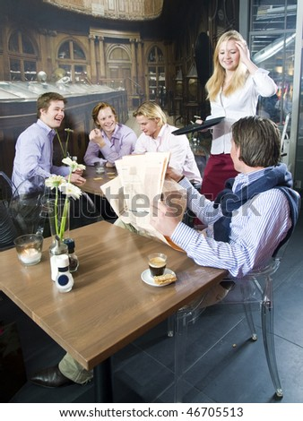 A group of happy people having a drink in a bar - stock photo
