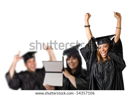 A group of high school or college graduates cheering happily on graduation day. - stock photo