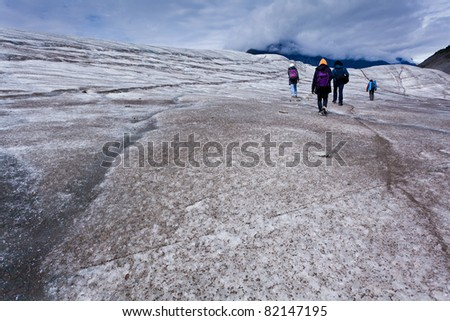 A group of hikers hiking root glacier in alaska