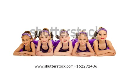 A Group of Junior Petite Tap Dancer Kids in Recital Costume - stock photo