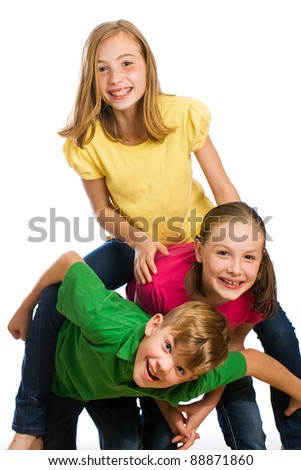 A group of kids wearing colorful shirts having fun. - stock photo