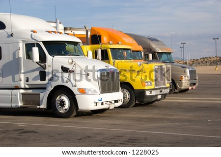 a group of large trucks in a row