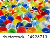 A group of marbles in strong primary colors. - stock photo
