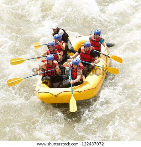 A group of men and women, with a guide, white water rafting on the Patate river, Ecuador - stock photo