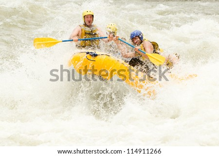 A GROUP OF MEN AND WOMEN, WITH A GUIDE, WHITEWATER RAFTING ON THE PASTAZA RIVER, ECUADOR  - stock photo