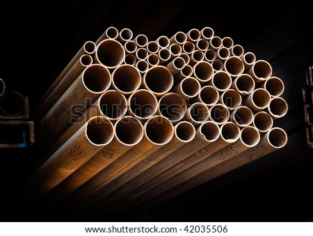 A group of   metal pipes on  shelf - stock photo