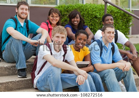 A group of muliethnic university students, friends smiling expressing happiness - stock photo