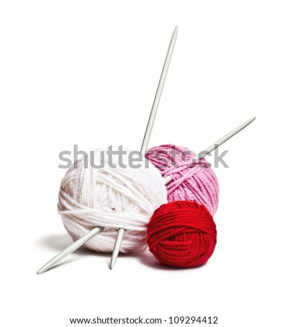 a group of multi-colored balls of yarn and knitting needles on a white background - stock photo