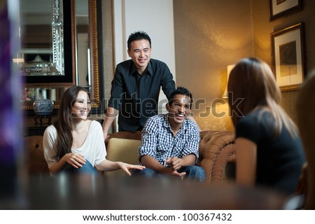 A group of multiracial friends hanging out together - stock photo