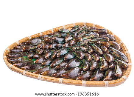 A group of mussel in a wicker tray over white background