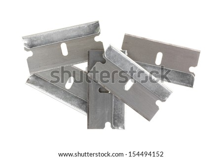 A group of new razor blades on a white background. - stock photo