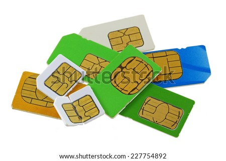 A group of old and used Subscriber Identity Module (SIM) cards, one is bent and broken - stock photo