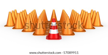 A group of orange traffic cones with a red one in front of the others - stock photo