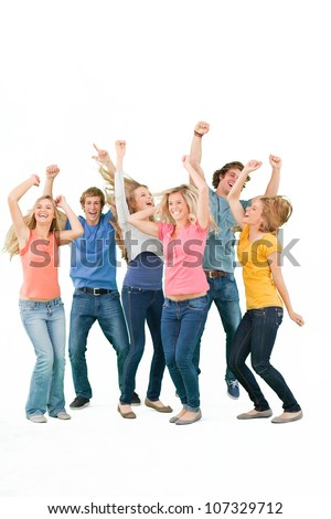 A group of partying friends smiling and laughing and dancing