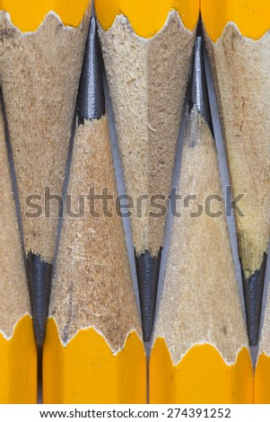 A group of pencils isolated on white. The pencils tips are nearly touching each other. This is a macro image.  - stock photo
