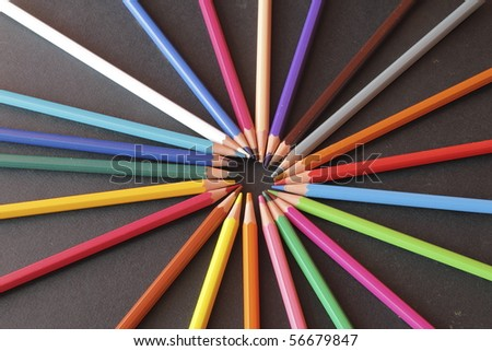 a group of pencils of various colors placed in a circle - stock photo
