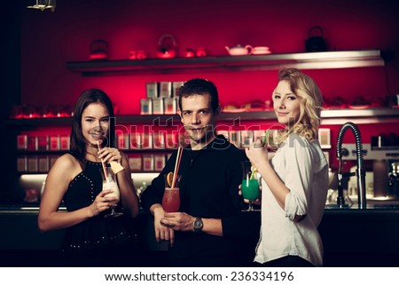 A group of people drinking cocktail in a night club and having fun