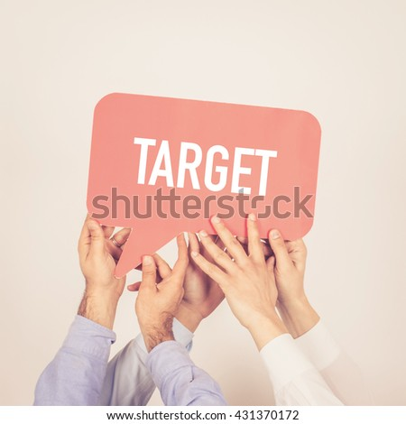 A group of people holding the Target written speech bubble - stock photo