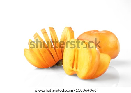 a group of persimmon and sliced  on white background - stock photo