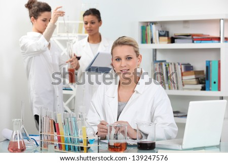 A group of scientists carrying out experiments - stock photo