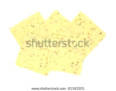 A group of several slices of pepper jack cheese on a white background. - stock photo