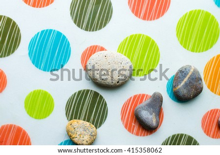 A group of smooth stones on the floor