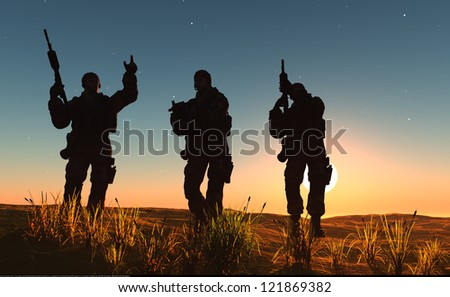A group of soldiers against the dawn. - stock photo