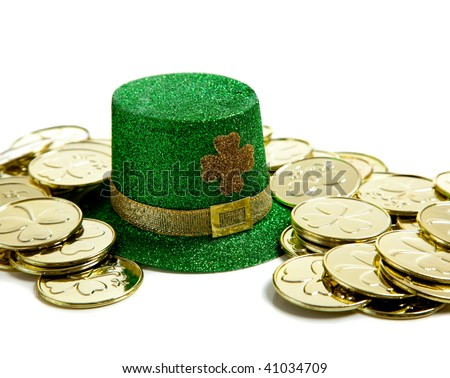 A group of St. Patricks Day decoations with a leprchaun hat and gold coins - stock photo