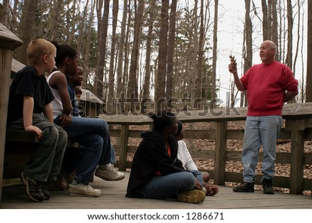 A group of student on a field trip. - stock photo