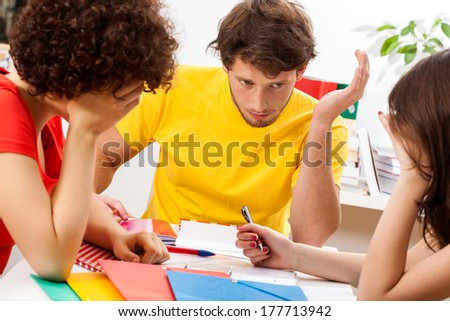 A group of students at the university studying for an exam - stock photo