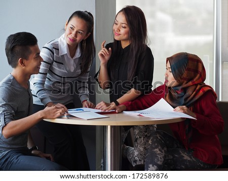A group of students in discussion - stock photo