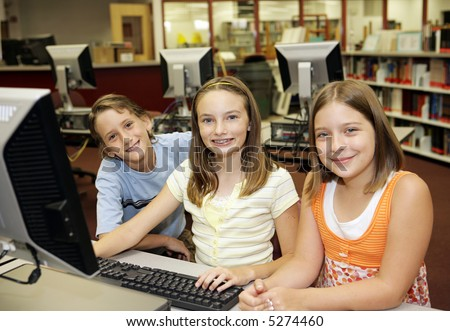 A group of students learning computers in school.