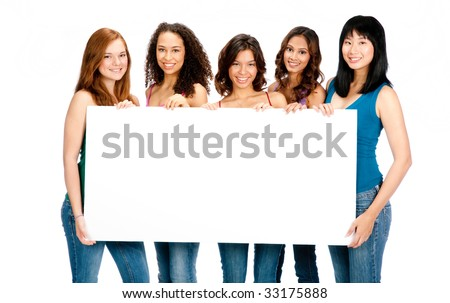 A group of teenagers with diverse ethnicities holding up a blank sign against white background - stock photo