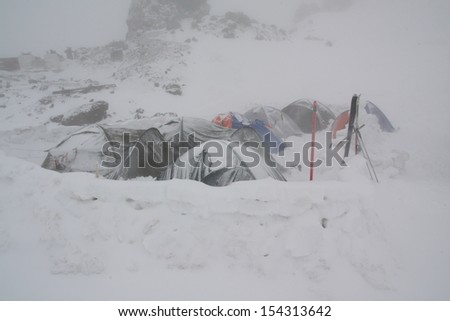 A group of tents in Caucasus mountains - stock photo