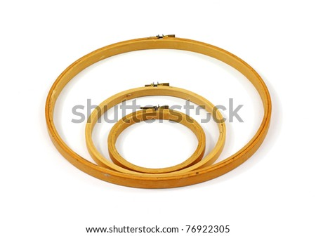 A group of three old wooden embroidery hoops. - stock photo